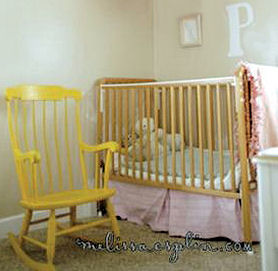 Pink, taupe and yellow baby girl nursery room design with an old rocking chair painted yellow