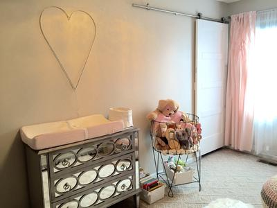 Sliding barn doors in a baby girl nursery
