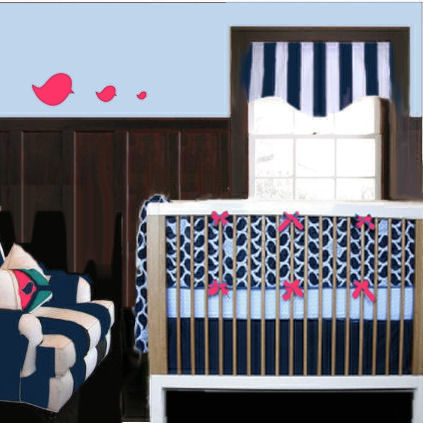 Black and white stripes in a baby girl nursery room with hot pink bird wall decals and bows on the crib