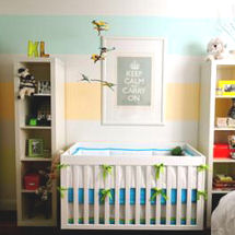 Aqua blue yellow and white gender neutral nursery with painted wall stripes