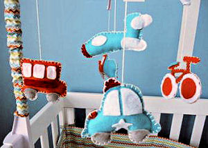 Homemade DIY Baby Crib Mobile with Cars a Bus and Bicycle Made from Felt