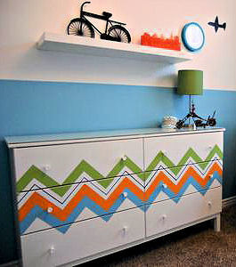 Painted chevron stripes in bright colors on a baby nursery dresser