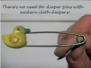 Old-fashioned, vintage baby ducky, yellow duck diaper pins.