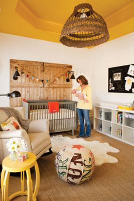 Rustic baby boy nursery room with onesie wall decorations