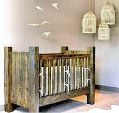 A rustic homemade wooden baby crib for a country nursery room