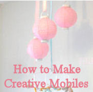Baby crib mobile for a pink nursery made from paper party lanterns