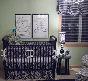 A crib painted black in a neutral theme nursery decorated for baby boy and girl  twins