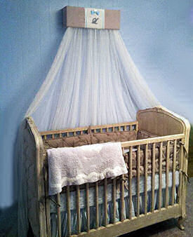 Blue and brown baby boy nursery with burlap crib canopy