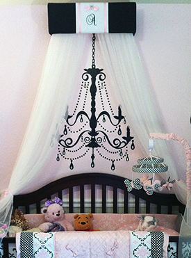 Custom made baby bed canopy in an elegant pink and black nursery decorated for a baby girl