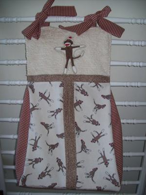 Custom made baby sock monkey diaper stacker and organizer for the nursery
