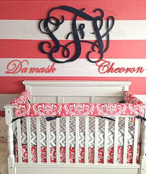 Custom baby crib bedding set in watermelon pink and white damask pattern with a white and gray chevron fitted crib sheet
