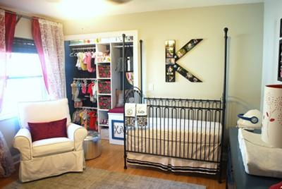 Chris and Kara's baby girl, Kara's, nursery.  The  nursery's color scheme is blue, gray and white with dark pink accent pieces.