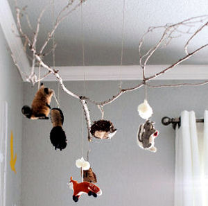 DIY homemade tree branch baby mobile with forest animals for the nursery
