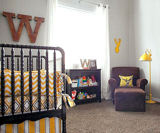 Whitetail deer themed baby boy nursery with DIY rustic decorations and custom made chevron crib bedding set