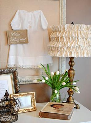 Vintage baby christening gown included in the wall decor of a neutral color nursery room