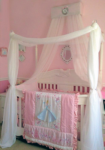 DIY crib canopy in a baby girl Disney theme nursery