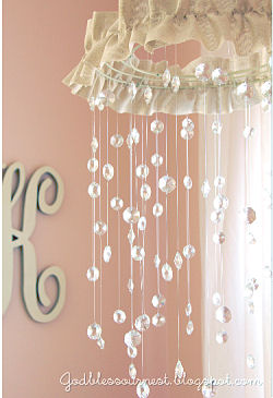 DIY baby crib mobile handmade using crystals from mom and dad's wedding