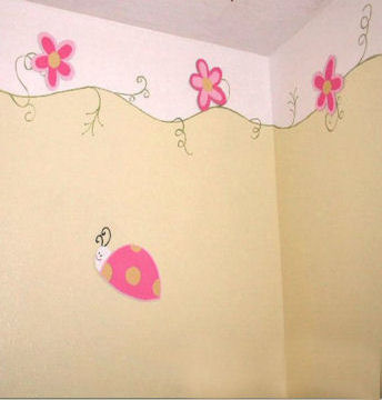 DIY hand painted pink ladybug wall border in a baby girl nursery craft project