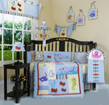 Dolphin nursery ideas with dolphin baby bedding with fish and sea creatures on the crib quilt