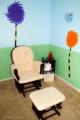 Dr. Seuss Truffula Trees Nursery behind our nursery glider rocker and ottoman.