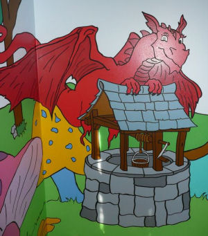 Red dragon tales dragon wall mural art in a baby nursery room