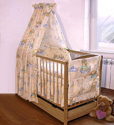A blue and yellow custom baby bedding set with a crib canopy sewn from fabric with a teddy bear and clouds pattern for a baby boy nursery room.
