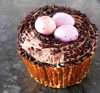 Easy homemade cupcakes for an Easter baby shower with egg nest frosting