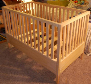 Easy wooden crib plans for a baby crib with stationery sides in the style of arts and crafts or mission furniture