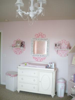 The Changing Area, Chandelier and Wall Decorations in our Whimsical and Elegant PInk Dreamland Baby Nursery Decor