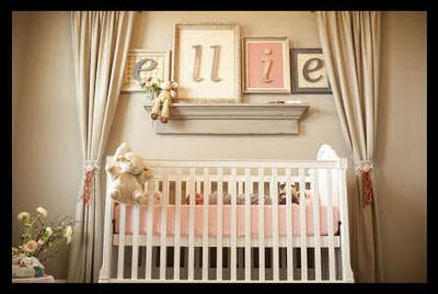 Ellie's nursery is a delight in baby girl pink, greige (a combination of gray and beige), and moss green.