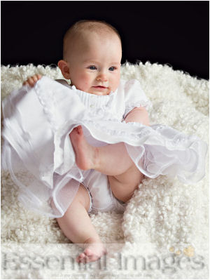 Newborn baby girl photo in white linen christening gown on fluffy chenille background photo props