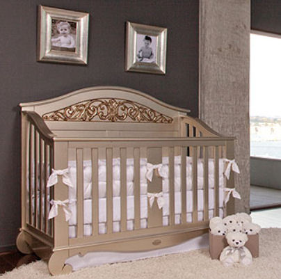 Elegant baby crib painted in metallic silver and gold paint