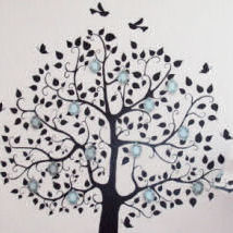 Family tree wall mural with photo frames on the branches in a baby girl nursery