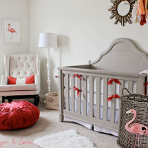 Modern flamingo nursery with a neutral color scheme decorated for a baby girl with pops of coral pink