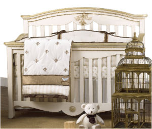 Antique gold metallic and ivory fleur de lis baby crib bedding set for a boy or girl nursery room