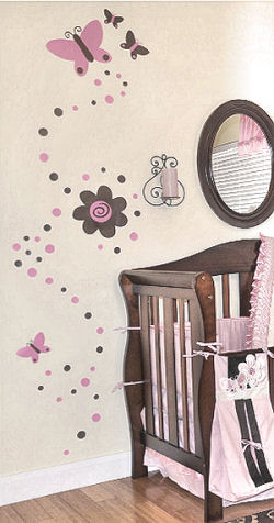 Pink and brown butterfly, polka dots and flower wall decals on the walls of a baby nursery