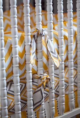Yellow and gray custom nursery bedding  looks amazing in a white painted Jenny Lind baby crib