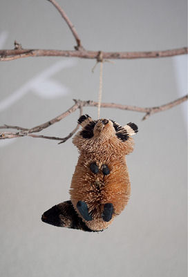 Stuffed toy raccoon decoration on a woodland creatures forest animals baby crib mobile