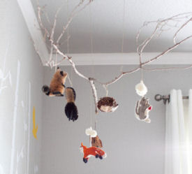 Tree branch baby nursery crib mobile with red fox deer badgers groundhogs porcupines and squirrels