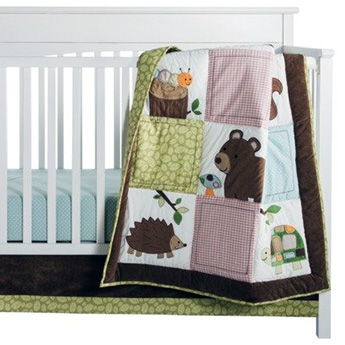 Woodland forest nursery theme ideas with hedgehogs bears baby deer bambi fox owl wildlife green brown with a rustic patchwork crib quilt