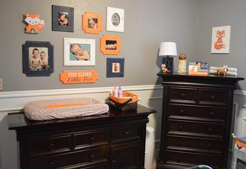 DIY picture wall collage in an orange and grey red fox and arrow baby nursery theme