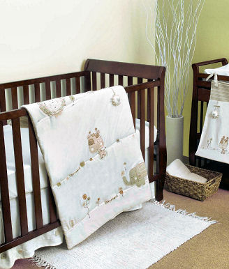 Gender neutral jungle safari nursery ideas with animals for a baby boy or girl in earth tones and antique white