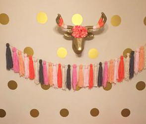 gold dots on baby nursery wall with metallic gold painted deer head and tassels garland