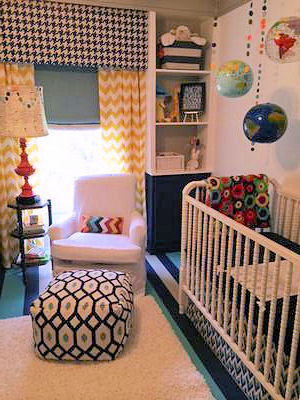 Baby boy nursery room decorated using a variety of popular fabric patterns including chevron window treatments