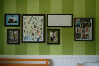 Artwork on the nursery walls includes an ABC letter collage and framed personal photographs
