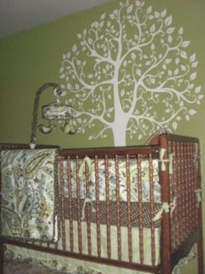 Our baby's green tree nature theme nursery with paisley crib bedding and bird baby mobile.
