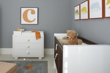 Bear themed baby nursery with gray walls and orange and white decorations