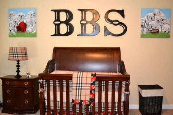 Masculine large wooden wall letters in a baby boy nursery room