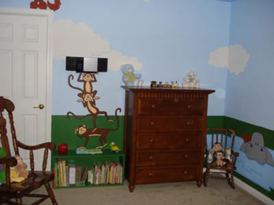 The funny monkeys that are painted on the walls of our baby boy's nursery seem to be standing on the bookshelf that my husband made for Jonas' room.