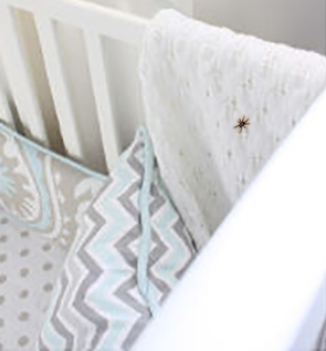 Spider inside a baby crib in the nursery